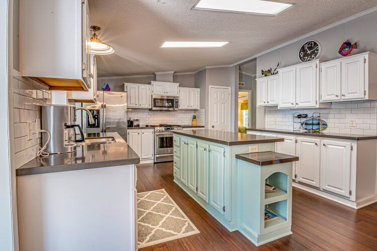 Coastal kitchen style - white and blue cabinets