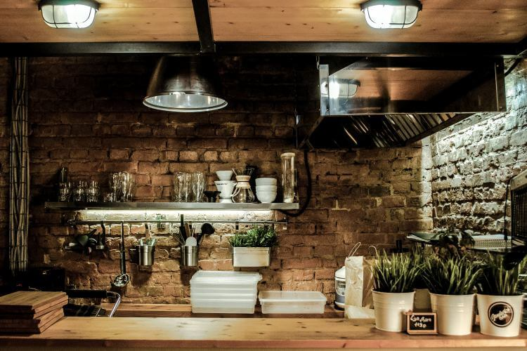 Industrial kitchen design with exposed brick